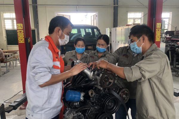 Students in practical session at Automotive repair class